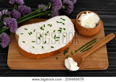 Cream cheese and chives on slice of bread