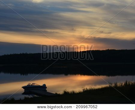 Evening on the beach, with fishing boat