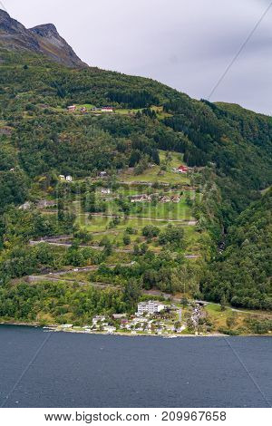 Geiranger is a small tourist village in Norway. It lies in Stranda at the head of the Geirangerfjorden which is a branch of the large Storfjorden. Geiranger is home to some of the most spectacular scenery in the world.