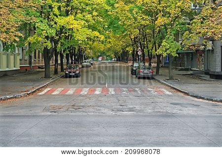 Dnipro Ukraine - October 06 2013: Autumn street of the Dnipro city in warm cloudy weather