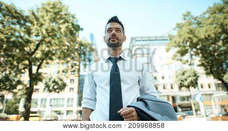 Portrait of dedicated businessman outdoors on street.