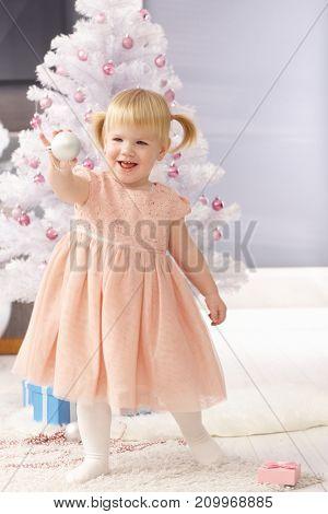 Happy little girl enjoying christmas celebration.