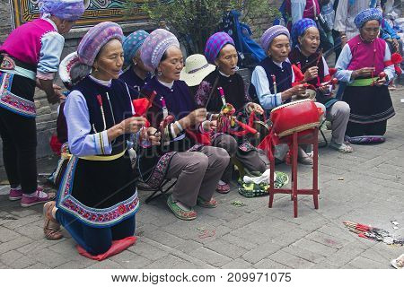DALI, CHINA - MAY, 21, 2014 : Chinese women playing music at the Minotities festival in Dali - Yunnan, China.
