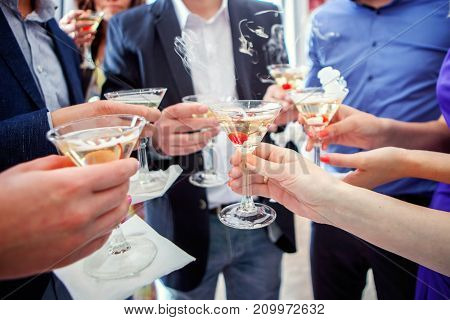 Celebration. People holding glasses of champagne making a toast, hands with glasses close up