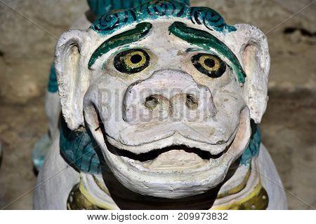Buddhist snow lion an old stone sculpture from Zanskar Northern India.