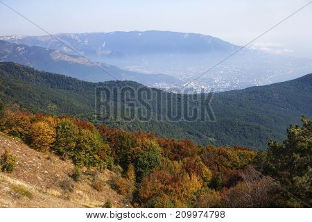 The city at the foot of the Bear Mountain and the colorful forest. Russia, the Crimea