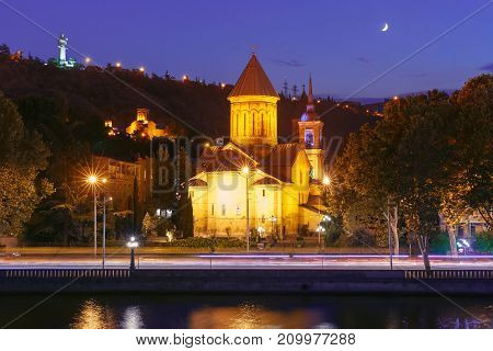 Amazing View of Sioni Cathedral of Dormition and Kura river in Old Town in the moonlit night, Tbilisi, Georgia