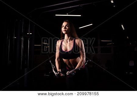 Strong Sporty girl in gym doing exercises.
