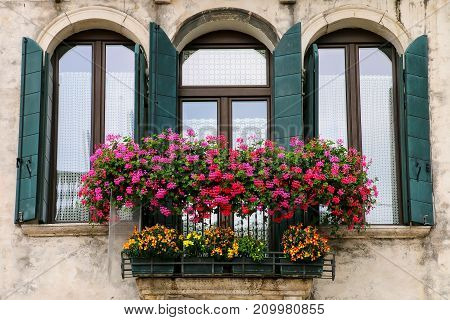 Detail Of A Building With Window And Flower Box In Venice, Italy