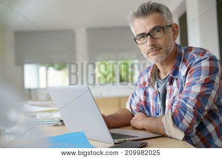 Businessman working on laptop computer