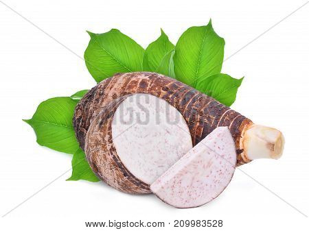 whole and slice with green leaves of taro root isolated on white background