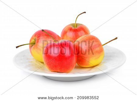 red dwarf apple in white plate isolated on white background