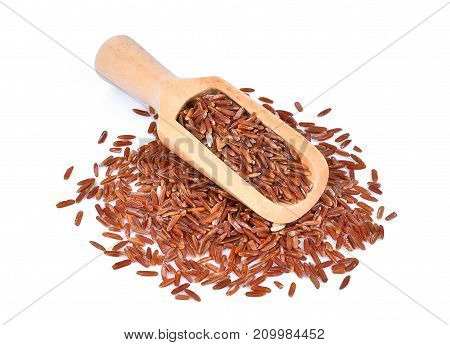 top view of brown rice in wooden scoop isolated isolated on white background
