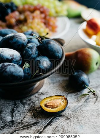 Ripe plums in a bowl