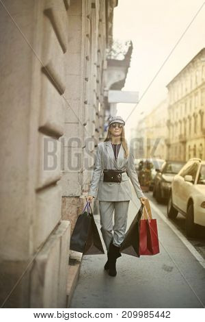 Carrying shopping bags in the street
