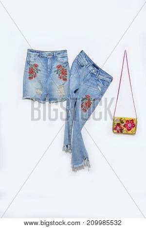 Embroidered flowers jeans with skirt with handbag isolated