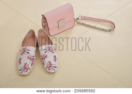 floral shoe with handbag isolated - beige background