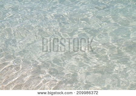 Clean and clear sea water that can be seen the sand on the bottom of seawater