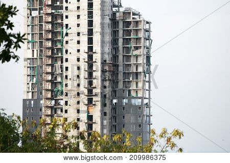 High rise building in under construction with the white sky