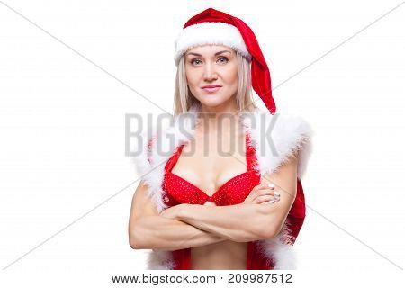 Christmas. Sport, activity. Muscular beautiful sexy girl wearing santa claus clothes isolated on white.
