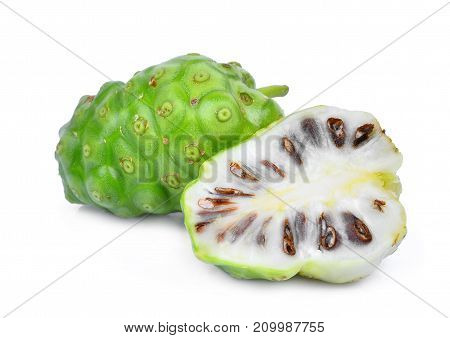 whole and half of noni fruit isolated on white background