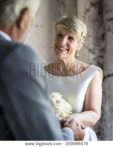 Senior Couple with Flower Bouquet