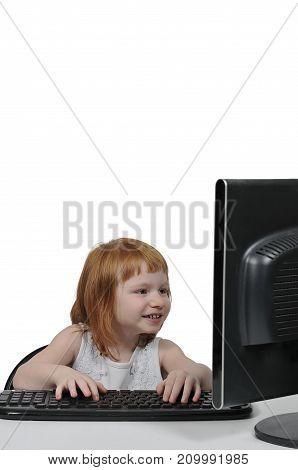Computer savvy little girl using a desktop computer