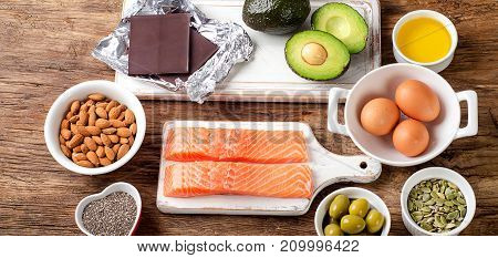 Selection Of Healthy Fat Sources On Wooden Background