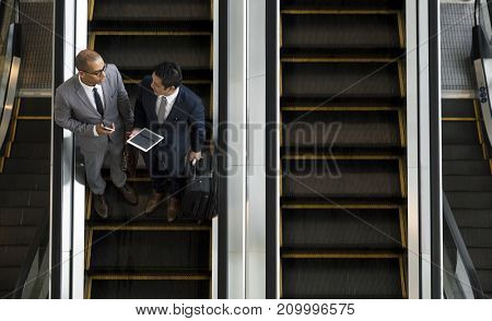 Business Men Talk Tablet Escalator