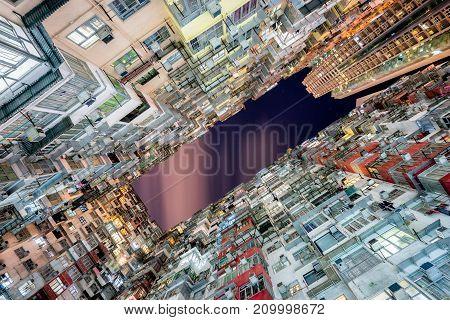 HongKong. Old tall and dense residential building in Hong Kong at dusk.
