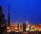 Dubai downtown night scene with city lights poster