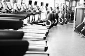 fitness facility center gym interior health club with sports training equipment for aerobic exercise workout and bodybuilding poster