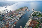 Bergen is a city and municipality in Hordaland on the west coast of Norway. Bergen is the second-largest city in Norway. The view from the height of bird flight. Aerial FPV drone photography. poster