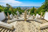 Tenoes in north of Portugal. The monumental baroque staircase of Bom Jesus do Monte Sanctuary, a popular pilgrimage destination with panoramic views overlooking Braga cityscape from top of mountain. poster