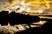 Beautiful yellow Sunset with clouds on the Arno River in Florence, Italy poster