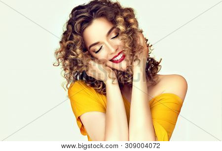 Beautiful Curly Hair. Smiling Girl With Healthy Wavy Long Blonde Hair. Portrait Happy Woman With Bea