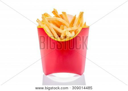 French Fries Potatoes In Red Fry Box Isolated On White Background With Reflection