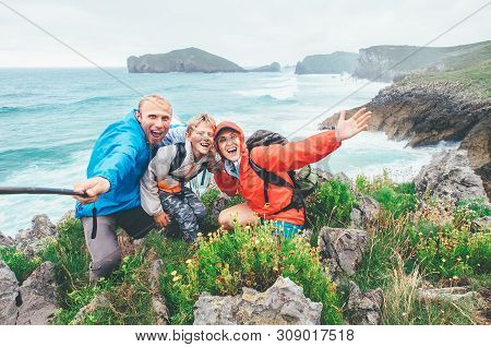 Happy Travelers Two Parents Family With Their Little Son On The Cantabrian Sea Coast Cheerfully Posi