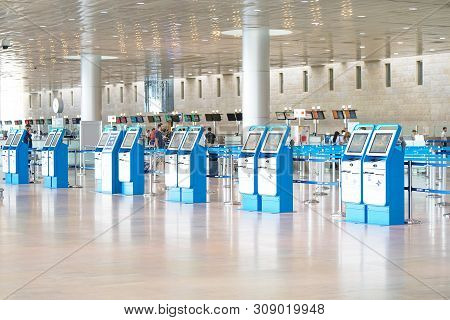 Empty Check-in Counters In Airport Building. Empty Halls Of The Ben Gurion International Airport. 29