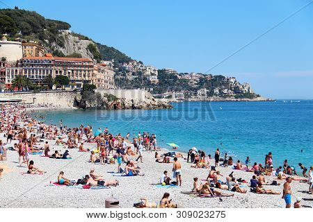 Nice, France - June 22, 2016: Crowded Castle Beach And Cityscape Of Nice, Cote Dazur
