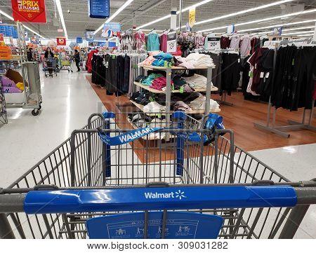 Montreal, Canada - April 30, 2019: Empty Branded Walmart Shopping Cart In Walmart Store. Walmart Is