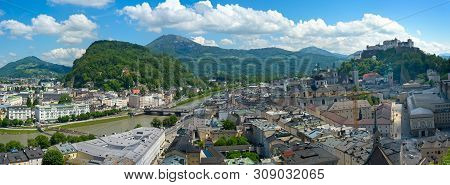 Panorama Of Salzburg, Austria, Looking Over The Historic Old Town, With The Salzach River, The Hills