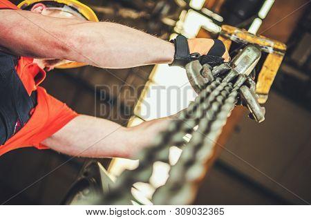 Caucasian Heavy Duty Chain Lift Operator. Industrial Equipment.