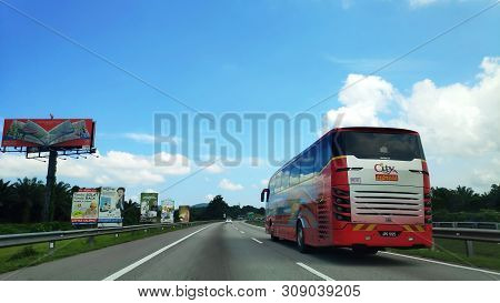 Johor Bahru, Malaysia- 25 Jun, 2019: Tourist Bus Travel Along North South Highway In Malaysia. The N