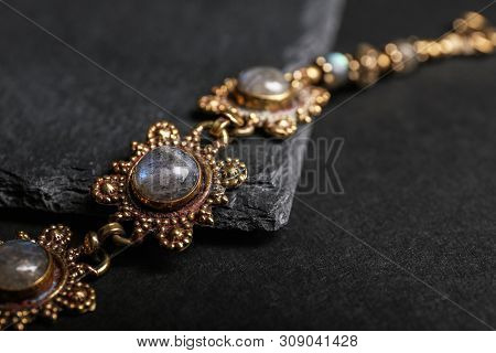 Elegant Bracelet On Black Background, Closeup. Luxury Jewelry