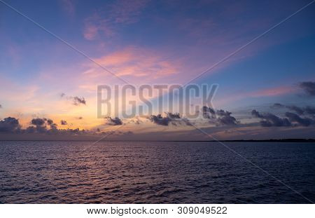 Beautiful Sunrise Or Sunset Sky On The Beach. Sunset Sky Into The Sea With Wave, Horizon, Blue And G