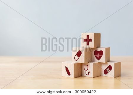 Wood Block Stacking With Icon Healthcare Medical, Insurance For Your Health Concept