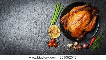 Roasted Chicken / Baked Whole Chicken Grilled With Herbs And Spices And Dark Background On Top View