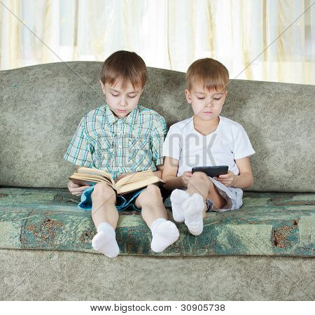 Two Reading Boys. With Paper Book And Electronic Book