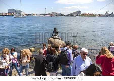Copenhagen, Denmark - June 22, 2019: Group Of Tourists Taking Photos Of The Little Mermaid, Characte